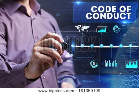 Technology, Internet, Business And Marketing. Young Business Person Sees The Word: Code Of Conduct
