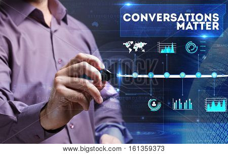 Technology, Internet, Business And Marketing. Young Business Person Sees The Word: Conversations Mat