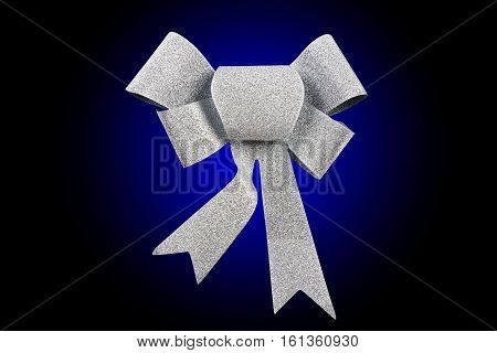 silver ribbon bow isolated on blue rounded background, studio shot