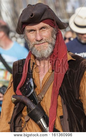 ROSTOCK / GERMANY - AUGUST 10, 2014: a man in a pirate costume walks on the Hanse Sail. The Hanse Sail is the largest maritime festival in Mecklenburg / Germany and one of the largest in Europe.