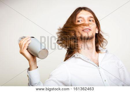 Long Haired Barman Shaking Head.