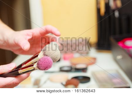 Person Holding Makeup Brushes For Blush And Powder