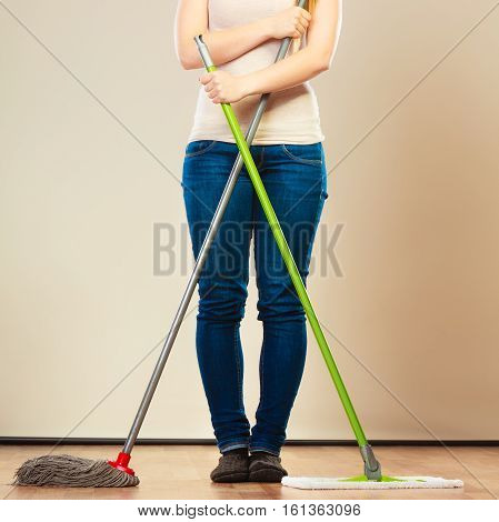 Cleanup housework concept. Cleaning woman legs girl mopping floor holding two mops new and old
