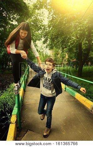 siblings boy girl fun teenager climb naughty outdoor active