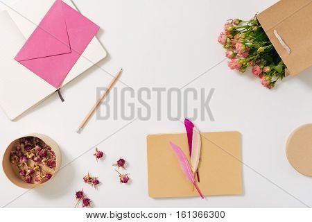 Talent and creativity. Flat lay of the pencil lying between the open notebook and a box with dried flowers