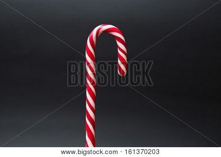 Red White Striped Candy Cane  on Dark Background