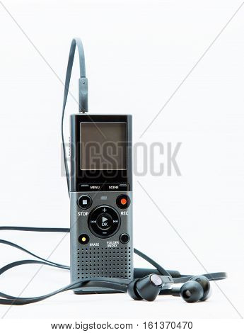 Sound recorder with headphones on white background