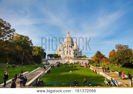 PARIS - NOVEMBER 3: Basilica of the Sacred Heart of Paris (Sacre-Coeur) on November 3 2016 in Paris France. A popular landmark the basilica is located at the summit of the butte Montmartre the highest point in the city.