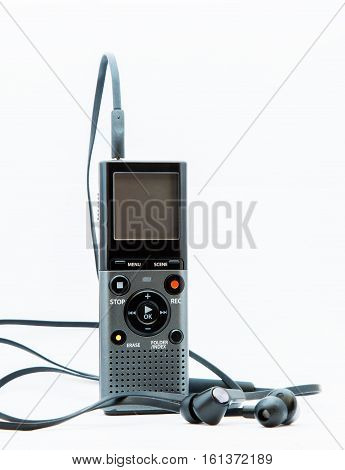 Sound recoredr with headphones on white background