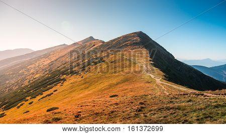 Tourist Hiking Trail in the Mountains on Sunny Day. Low Tatras Ridge Slovakia.
