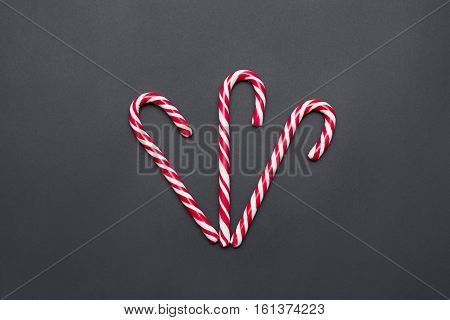 Three Candy Canes Together on Dark Background