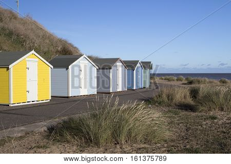 Beach huts at Pakefield Suffolk England against a blue sky