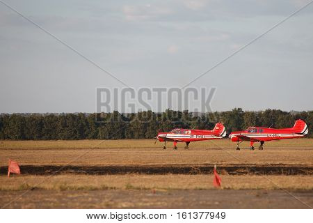 two small light aircraft on the ground