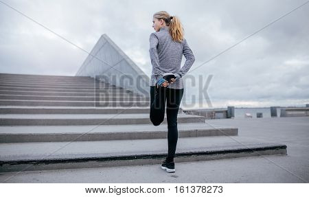 Fitness Woman Stretching Before Jogging