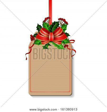 Christmas decoration with bow and holly and rowan berries on tag with free space