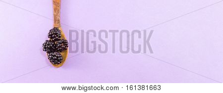 Blackberries In A Wooden Spoon