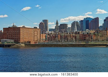 Boston, USA - April 28, 2015: Riverside and the tallest buildings of Boston USA. The city is located near different water facilities and people often use water transport to reach their destinations in order to avoid traffic.