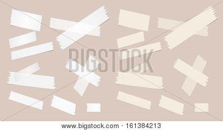 Different size sticky paper, adhesive, masking tape are on brown background.