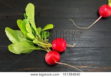 Radishes On A Black Table