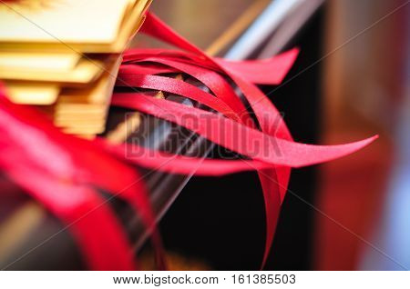 romance gold wedding invitation with red ribbon