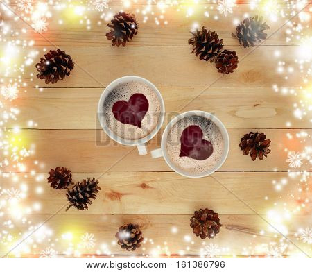 Two hot beverage cups snowflakes bokeh cones on the old wooden background. Top view. The festive mood. Morning. Winter and warmth of relations. Private conversation. Time for two. Love. Romance.
