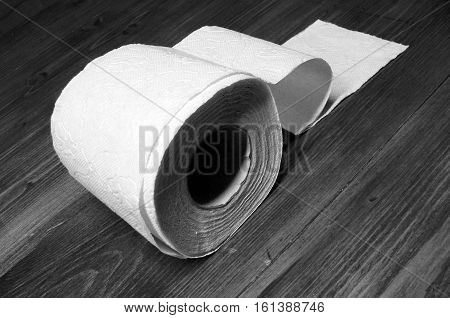 Toilet paper roll on the wooden table