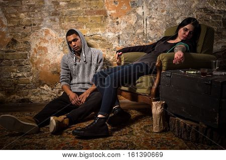 Drug addict sleeping after taking drugs. Man and woman with AIDS resting and relaxing. Disease concept. Drugs concept.