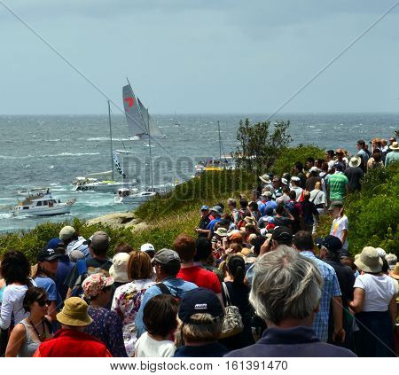 Sydney Australia - December 26 2012. Wild Oats reached Tasman Sea. Spectators watching the race from South Head. Sydney to Hobart Yacht Race starting in Sydney on Boxing Day and finishing in Hobart.