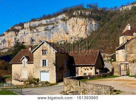 View o the Baume-les-Messieurs village in the Jura department of Franche-Comte. Baume-les-Messieurs is classified as one of the most beautiful villages of France