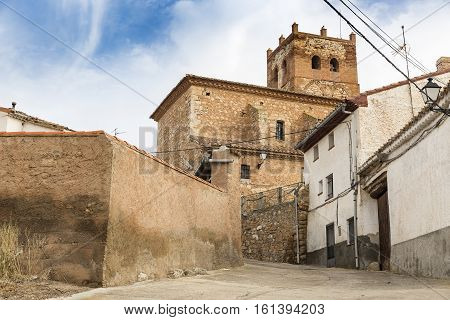a view of Cuencabuena town and the Santos Justo Y Pastor parish church, province of Teruel, Spain