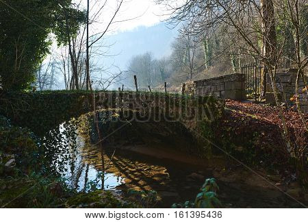 Small river runs through the centre of the Baume-les-Messieurs village. Jura department of Franche-Comte. Baume-les-Messieurs is classified as one of the most beautiful villages of France