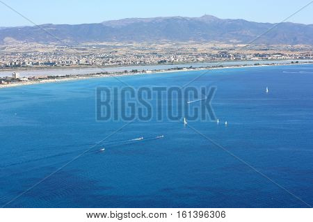 Beautiful aerial view on the city and Golf of Cagliari with white boats and the beach il Poetto in Sardinia Italy.