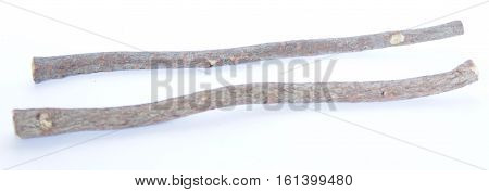 two liquorice (or licorice) root sticks isolated on white background
