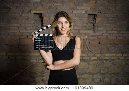 Young Blonde Actress Smiling With Movie Clapper