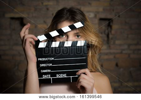 Young Green Eyes Blonde Woman With Movie Clapper