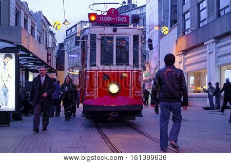 Istanbul Turkey - March 12 2013: Historic tram on Istiklal Avenue.Istiklal Avenue in the Beyoglu district of Istanbul. The former tram on Istiklal Street in Istanbul Taksim-Tunel carry passengers.