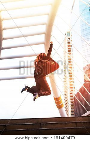 Business Woman  Holding Bag And Jump Over The Stair In Winner Pose With Formal Suit. In Rush Hour At