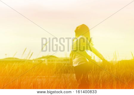 Young Woman Standing At Relax Pose Or Freedom Pose Or Chill Pose On The Meadow During Sunrise At Mor