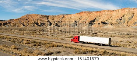 A trucker navigates this Utah highway in his big rig
