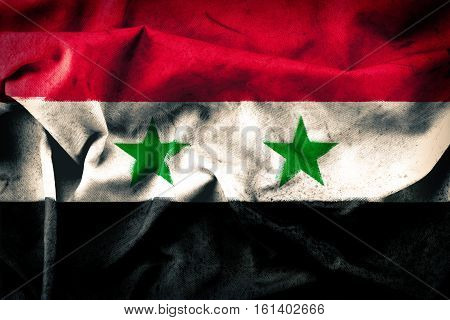 Grunge style of Syria flag - waving fabric background