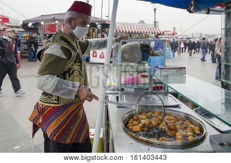 Istanbul Turkey - March 29 2013: Eminonu traditional ottoman bite sweet sellers made in boiling oil. There is no denying that desserts are a massive part of Turkish culture. When walking around Istanbul you can see a sweet seller just on almost every corn