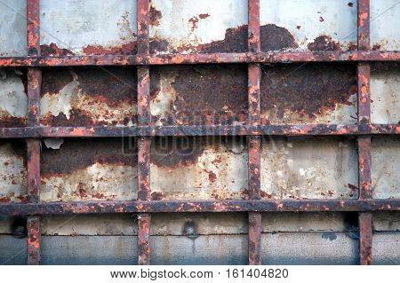 Abstract ,texture and background of vintage steel door eroding rust.