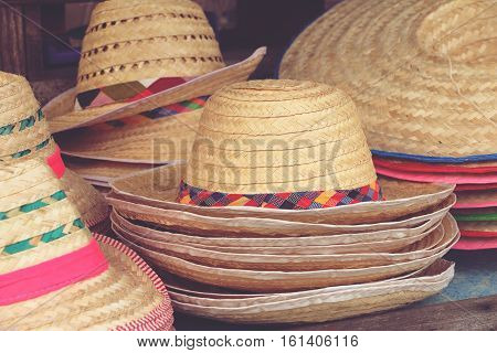 handmade hats woven from bamboo on sale at market hand craft