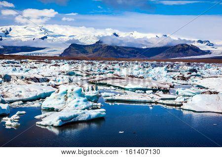Northern nature. Drift ice Ice Lagoon -Jokulsarlon. White-blue ice is piled up in turquoise water of the lagoon
