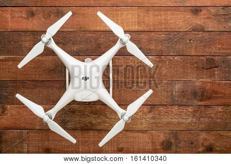FORT COLLINS, CO, USA - DECEMBER 11, 2016:  DJI Phantom 4 pro quadcopter drone on a rustic wooden  table with a copy space.