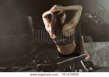 Toned picture of Asian woman doing sit-ups at gym Abdominal exercises Sit up.