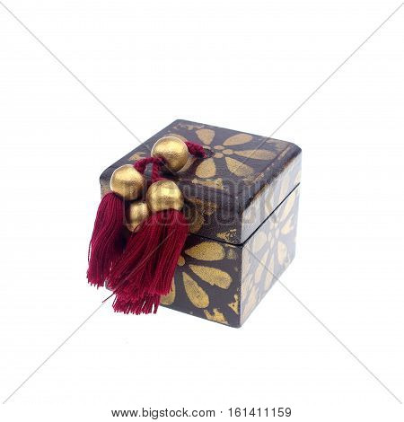 A wooden box decorated on a white background.