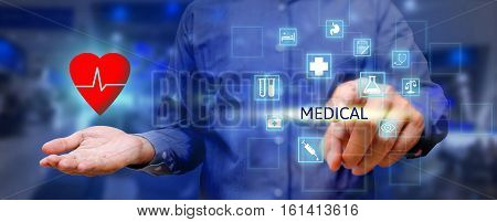 Healthcare concept Hand man show holding heart in palm and pressing medical text icon.