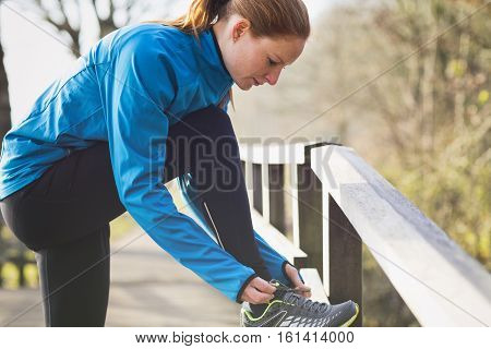 Jogger Tying Shoes