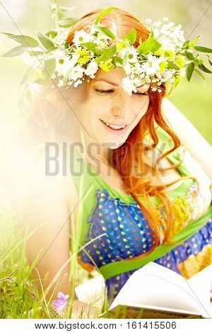 Woman in flower crown reading a book outdoors